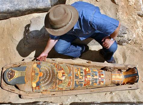 Zahi Hawass, chief of Egypt's Supreme Council of Antiquities, checks a brilliantly colored mummy dating back more than 2,300 years