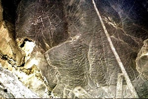 PARACAS GEOGLYPHS: Three figures made by the ancient Paracas culture can be seen outlined on the rocky hillsides near Palpa, southern Peru. The figures are known as the